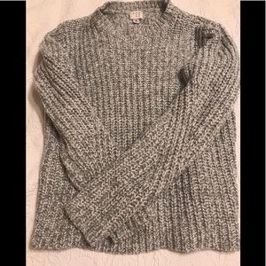 Gray sweater with a sparkly thread weaved in.